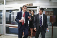 Sen. John Barrasso, R-Wyo., left, chairman of the Senate Republican Conference, and Sen. Todd Young, R-Ind., rush to the chamber for votes ahead of the approaching Memorial Day recess, at the Capitol in Washington, Thursday, May 27, 2021. Senate Republicans are ready to deploy the filibuster to block a commission on the Jan. 6 insurrection, shattering chances for a bipartisan probe of the deadly assault on the U.S. Capitol and reviving pressure to do away with the procedural tactic that critics say has lost its purpose. (AP Photo/J. Scott Applewhite)