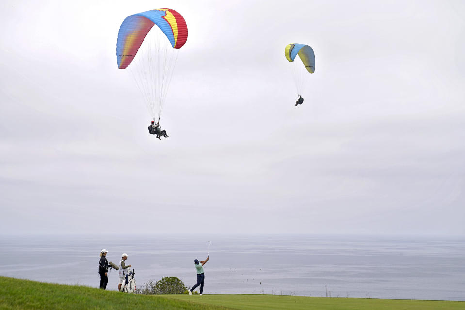 Brooks Koepka plays his shot from the fourth tee during the third round of the U.S. Open Golf Championship, Saturday, June 19, 2021, at Torrey Pines Golf Course in San Diego. (AP Photo/Jae C. Hong)