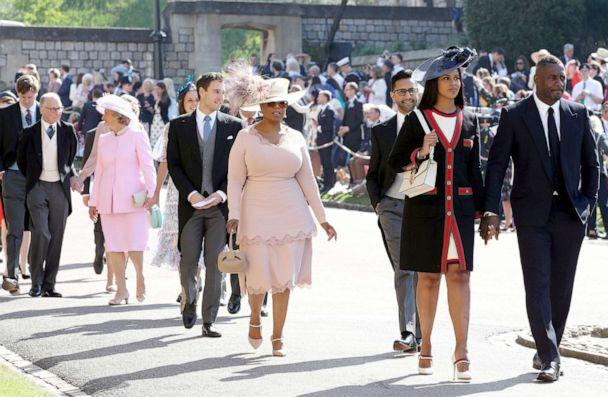 PHOTO: Oprah Winfrey, Idris Elba, Sabrina Dhowre and other guests arrive at St George's Chapel at Windsor Castle for the wedding of Meghan Markle and Prince Harry, May 19, 2018. (Pool New/Reuters)