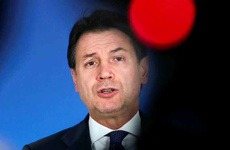 Italian Prime Minister Giuseppe Conte holds a news conference at the end of an EU summit in Brussels