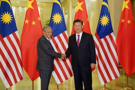 Chinese President Xi Jinping shakes hands with Malaysian Prime Minister Mahathir Mohamad before the bilateral meeting of the Second Belt and Road Forum at the Great Hall of the People in Beijing, China, April 25, 2019. Andrea Verdelli/Pool via REUTERS  *** Local Caption *** BEIJING, CHINA - APRIL 25: Chinese President Xi Jinping shakes hands with Malaysian Prime Minister Mahathir Mohamad before the bilateral meeting of the Second Belt and Road Forum at the Great Hall of the People on April 25, 2019 in Beijing, China. (Photo b