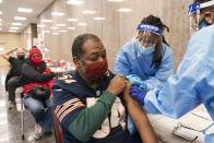 In this Thursday, Feb. 11, 2021, photo Peter Thomas, 58, of Washington, receives his second dose of the COVID-19 vaccine at a clinic at Howard University, in Washington. (AP Photo/Jacquelyn Martin)