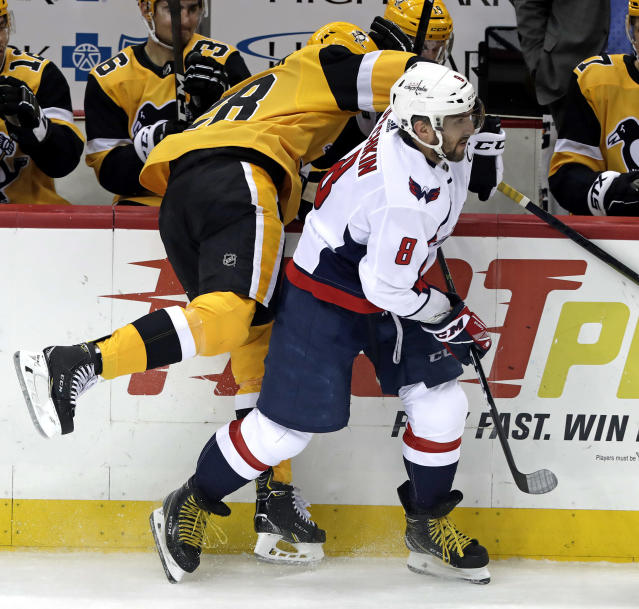 Washington Capitals' Alex Ovechkin (8) checks Pittsburgh Penguins' Marcus Pettersson (28) into the boards during the first period of an NHL hockey game in Pittsburgh, Tuesday, March 12, 2019. (AP Photo/Gene J. Puskar)