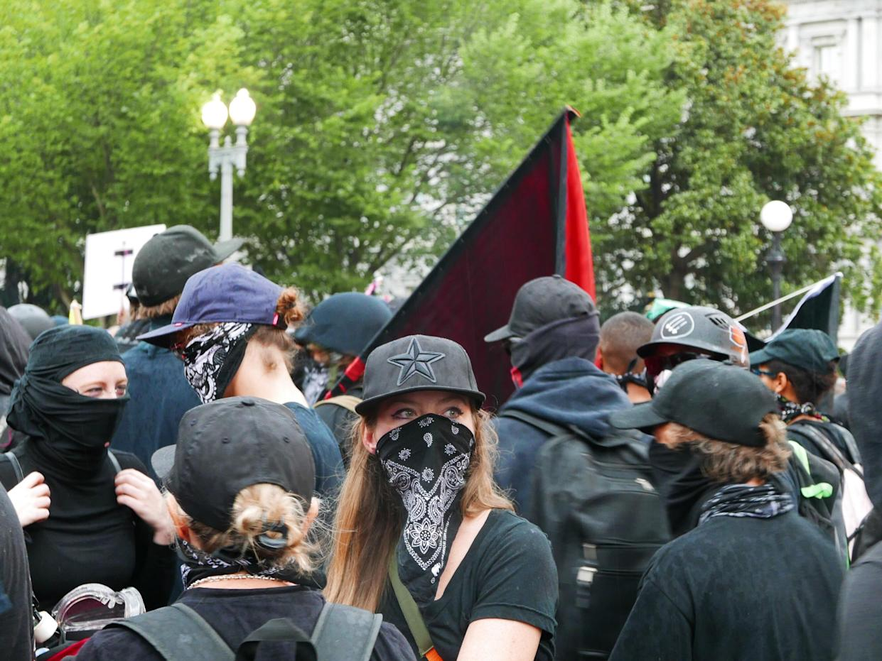 Many counterprotesters wore masks or other protective gear. (Photo: Hunter Walker/Yahoo News)