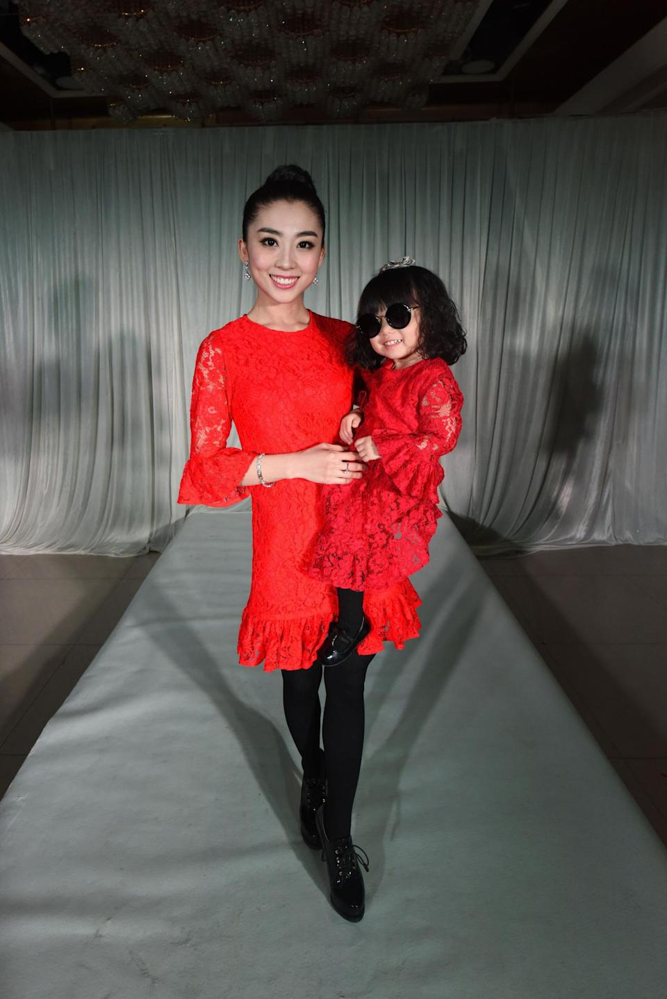 If this wasn't a fake fashion show in China, one could assume they were taking part in Dolce & Gabbana's most recent runway show that celebrated families. But, alas, this pair just threw their own over-the-top fashion party.