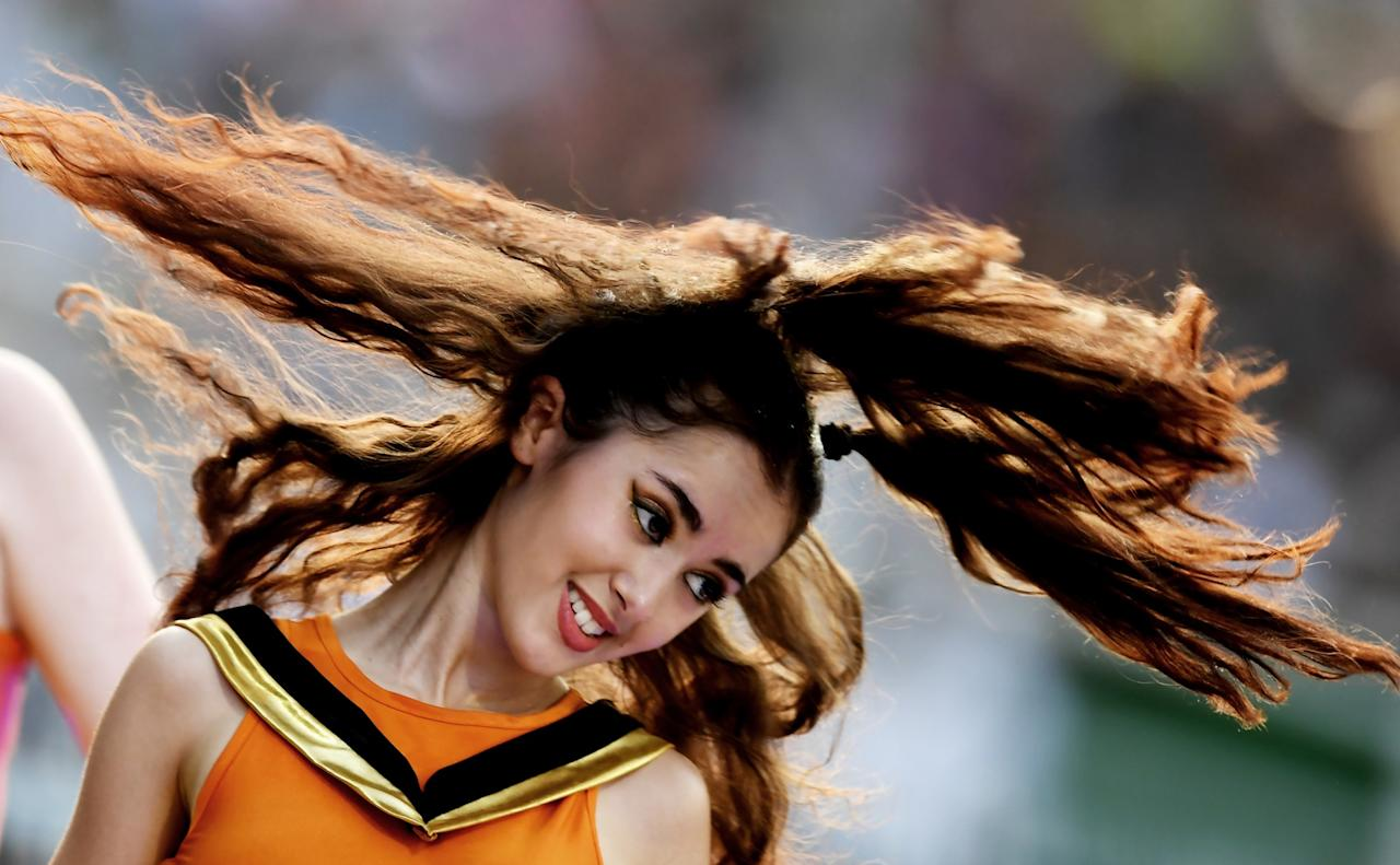 <p>A Cheerleader of Sunrisers Hyderabad performs a routine during the 2017 Indian Premier League (IPL) Twenty20 cricket match between Kolkata Knight Riders and Sunrisers Hyderabad at The Eden Gardens Cricket Stadium in Kolkata on April 15, 2017. </p>