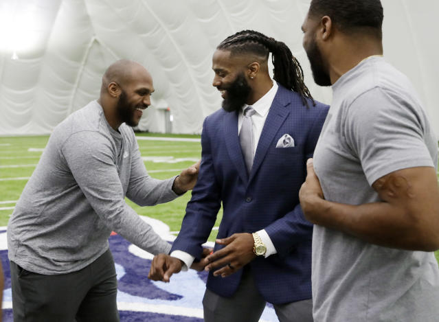 Former Tennessee Titans safety Michael Griffin, center, jokes with former teammates Jurrell Casey, left, and Wesley Woodyard, right, after Griffin signed a one-day contract with the team and then retired as a Titan Monday, May 7, 2018, in Nashville, Tenn. Griffin, a first-round pick by the Titans in 2007, played nine seasons for Tennessee. (AP Photo/Mark Humphrey)