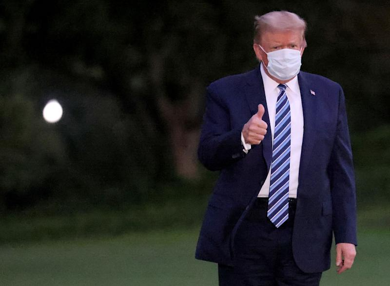 U.S. President Donald Trump gestures upon return to the White House from Walter Reed National Military Medical Center. Source: Getty