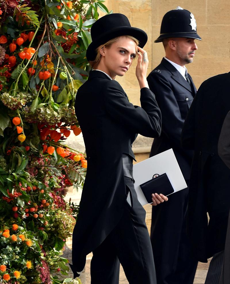 Model Cara Delevingne makes her way to the nuptials.