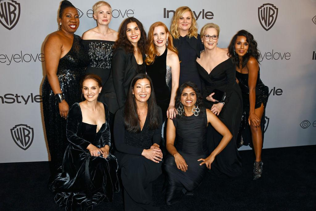 <p>The likes of activisits Tarana Burke, Saru Jayaraman and Ai-jen Poo posed alongside Natalie Portman et. al for a photograph which is sure to go down in history. <em>[Photo: Getty]</em> </p>