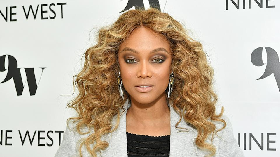 Tyra Banks poses on the red carpet