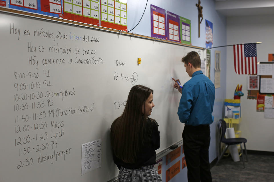 Students study Spanish at the St. John Paul II Catholic School in Phoenix, Ariz., on Feb. 26, 2020. In the western suburbs of Phoenix, enrollment is surging at this new Catholic high school built to serve a fast-growing, heavily Hispanic community. (AP Photo/Dario Lopez-MIlls)