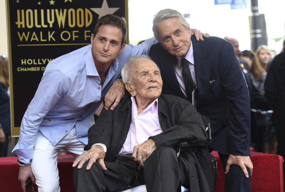 Honoree and actor Michael Douglas, from right, poses with his father actor Kirk Douglas and his son actor Cameron Douglas following a ceremony honoring him with a star on the Hollywood Walk of Fame on Tuesday, Nov. 6, 2018, in Los Angeles. (Photo by Chris Pizzello/Invision/AP)