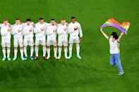 One fan invaded the pitch to brandish a rainbow flag