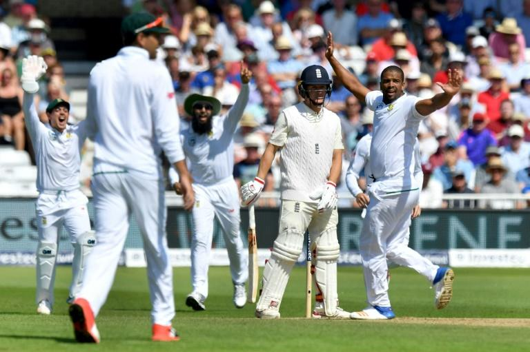 South Africa's Vernon Philander (R) celebrates taking the wicket of England's Gary Ballance, given out on review for 4, on the fourth day of the second Test at Trent Bridge in Nottingham, central England on July 17, 2017
