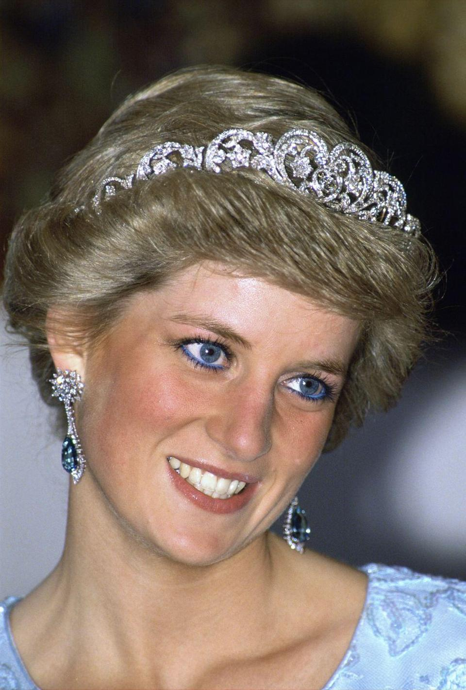 <p>Diana, Princess of Wales, attended a banquet during an official visit to Munich, Germany. The Princess paired the Spencer tiara with diamond and aquamarine earrings and, for a fun touch, bright blue eyeliner. </p>