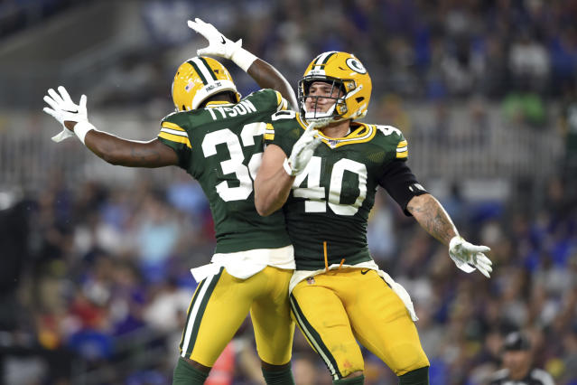 Green Bay Packers defensive back Mike Tyson (32) celebrates with linebacker Curtis Bolton (40) after Bolton caught an interception on a pass from Baltimore Ravens quarterback Trace McSorley during the first half of a NFL football preseason game, Thursday, Aug. 15, 2019, in Baltimore. (AP Photo/Gail Burton)
