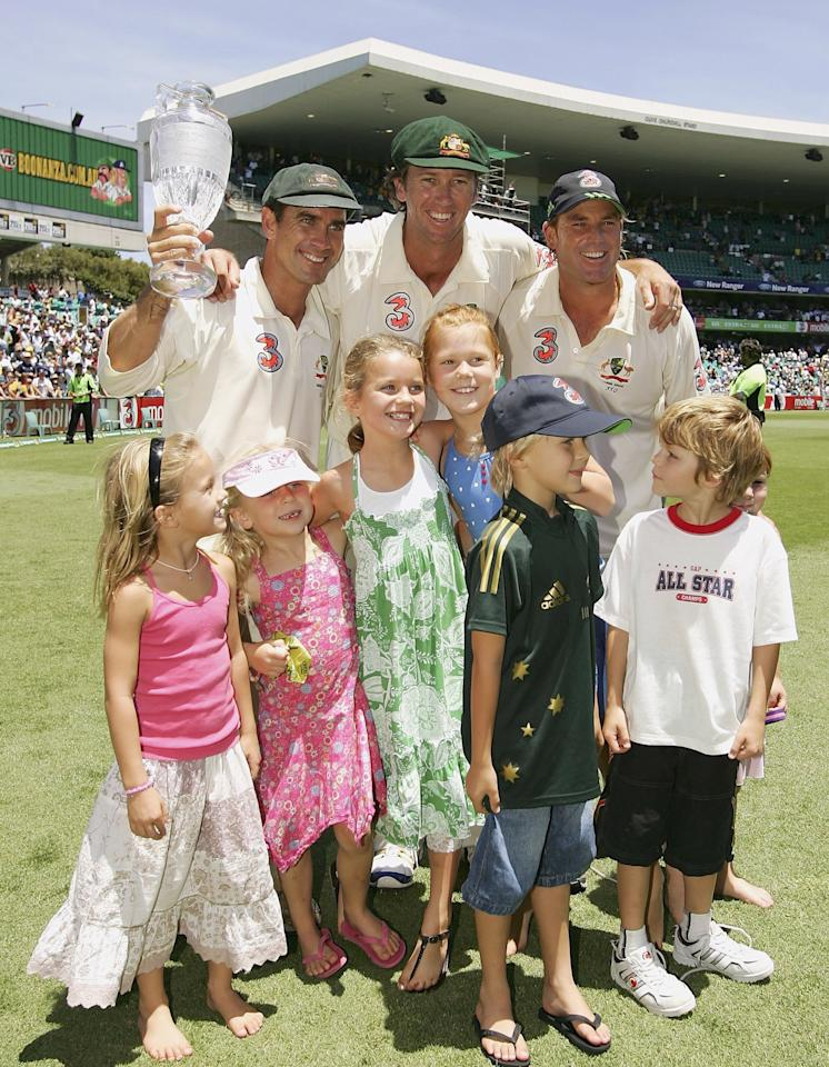 SYDNEY, AUSTRALIA - JANUARY 05:  (L-R) Justin Langer, Glenn McGrath and Shane Warne of Australia celebrate with the trophy and their children after winning the final test and wrapping up the series 5-0 after winning day four of the fifth Ashes Test Match between Australia and England at the Sydney Cricket Ground on January 5, 2007 in Sydney, Australia.  (Photo by Cameron Spencer/Getty Images)