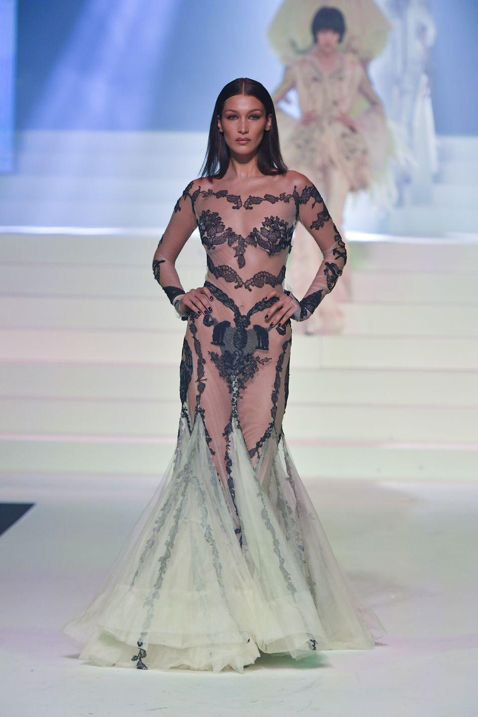 <p>This list is about 80% Bella Hadid at this point and I am NOT complaining. The supermodel wore next-to-nothing on the runway for Jean-Paul Gaultier's show at Paris Fashion Week – a see-through mermaid gown and a black lace thong. <em>Fashun.</em> </p>