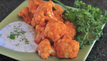 """<p>Buffalo wings, typically made from chicken, are often associated with watching sports. If you are looking for an alternative to Buffalo wings next time you are hosting game day, check out this recipe made entirely from cauliflower. That's right, cauliflower Buffalo wings are real, and they're spectacular. Not to mention this cruciferous vegetable has multiple health benefits including vitamin C, vitamin K, fiber, folate, minerals and anti-oxidants. <i>(Photo via <a rel=""""nofollow noopener"""" href=""""http://www.vegan.com/videos/cauliflower-buffalo-wings/"""" target=""""_blank"""" data-ylk=""""slk:vegan.com"""" class=""""link rapid-noclick-resp"""">vegan.com</a>)</i> </p>"""