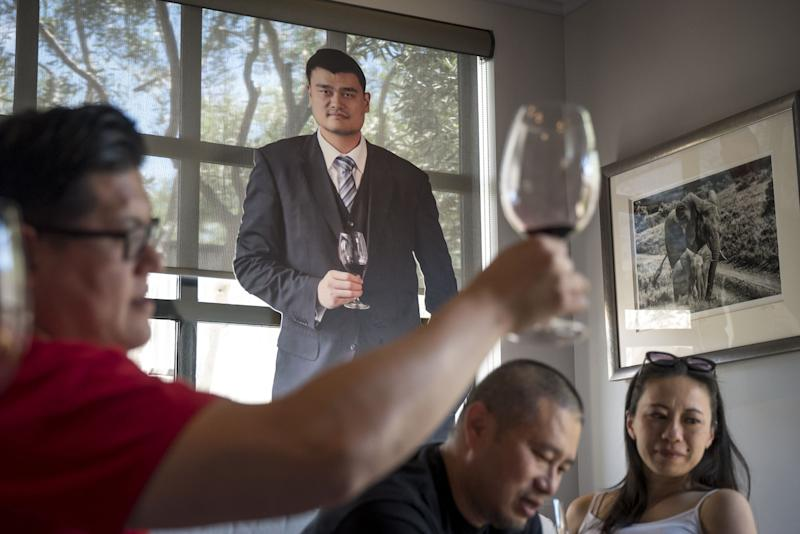 """(Bloomberg) -- A decade ago, basketball legend Yao Ming was such a celebrity in China that he carried the Olympic torch into Tiananmen Square.But these days, not even the 7-foot, 6-inch Yao can fight his way through the U.S.-China trade war.Yao's trouble involves, of all things, wine, his post-NBA business in Napa Valley. Across California, the state's signature wine business is getting hit by the tit-for-tat tariffs coming out of Washington and Beijing.China's latest round of retaliatory tariffs put the combined tax rate on a bottle of American wineat 93%, pushing prices out of reach for much of the Asian country's growing middle class. Yao Family Wines, started by the Hall of Famer in 2011, has seen its export business drop by half over the past year, said Tom Hinde, the vineyard's president and winemaker.California vintners large and small who have spent years building relationships with China are now seeing their work undone by the tariff dispute. Their travails illustrate the far-reaching effects of President Donald Trump's trade war, where carefully laid business plans from fishing rod suppliers to soybean farmers can turn on the latest headline, meeting or tweet.""""There's indecisiveness in the outcome, so that puts a pall over the buyers' enthusiasm,"""" Hinde said. """"We're hurting ourselves.""""The value of U.S. wine exports to China dropped by 25% in 2018, when the first retaliatory tariffs hit, from 2017, according to the San Francisco-based Wine Institute, an advocacy group for California's wine industry. The state, which accounts for more than 90% of America's wine sales to other countries, has borne the brunt of the decline.While China is the industry's fifth-largest export market, it's been viewed as a big opportunity for growth. Vintners worry that years of work cultivating business in the country could be ruined if tariffs persist and Chinese wine drinkers come to view American bottles as too expensive. And even if the levies end, business wouldn't automatic"""
