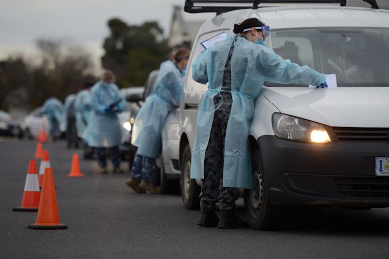 Members of the Australian Defence Force (ADF) gather information and conduct temperature checks at a drive-in Covid-19 testing site set up at the Melbourne Show Grounds in Melbourne, Victoria, Australia, on Tuesday, Jun 30, 2020. Victoria, Australia's second-most populous state, faces isolation from much of the country due to a spike in coronavirus cases that's jeopardizing the economic recovery. Photographer: Carla Gottgens/Bloomberg
