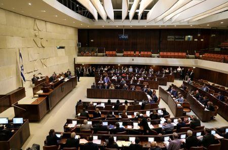 FILE PHOTO: Israeli lawmakers attend a vote on a bill at the Knesset, the Israeli parliament, in Jerusalem