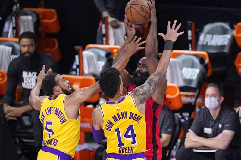 Los Angeles Lakers' Talen Horton-Tucker (5) and Danny Green (14) trap Houston Rockets' James Harden during the first half of an NBA conference semifinal playoff basketball game Thursday, Sept. 10, 2020, in Lake Buena Vista, Fla. (AP Photo/Mark J. Terrill)