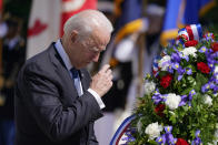 President Joe Biden makes the sign of the cross as he places a wreath at the Tomb of the Unknown Soldier at Arlington National Cemetery on Memorial Day, Monday, May 31, 2021, in Arlington, Va.(AP Photo/Alex Brandon)