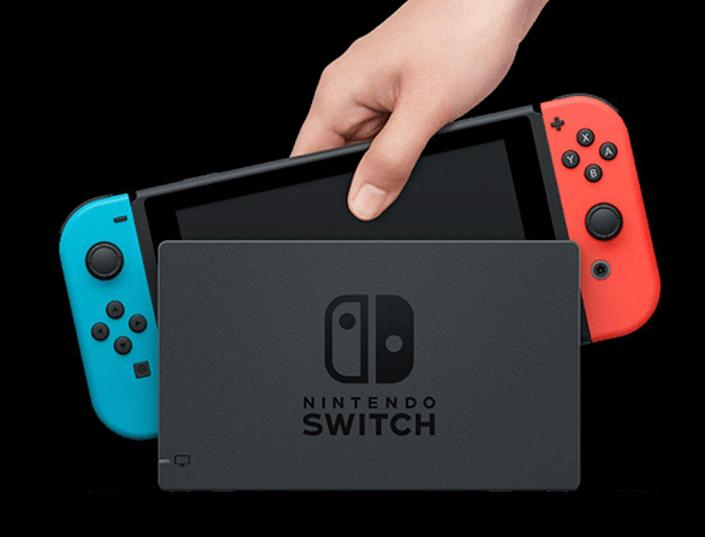 Hand pulls a Nintendo Switch from TV Stand