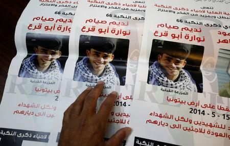 Pictures of 17-year-old Palestinina Nadim Nuwara are shown at the office of Accountability for Violence Against Children organization, in Ramallah, in the occupied West Bank April 25, 2018. REUTERS/Mohamad Torokman