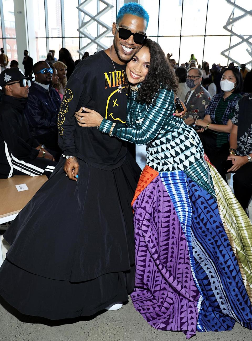 <p>Kid Cudi and Rosario Dawson are all smiles during New York Fashion Week while attending the Studio 189 presentation on Sept. 11 in N.Y.C.</p>