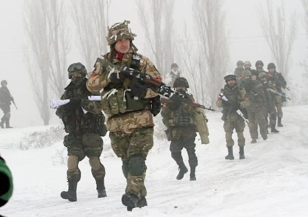 Ukrainian servicemen take part in operations in the Lysychansk district of Lugansk controlled by pro-Russian separatists