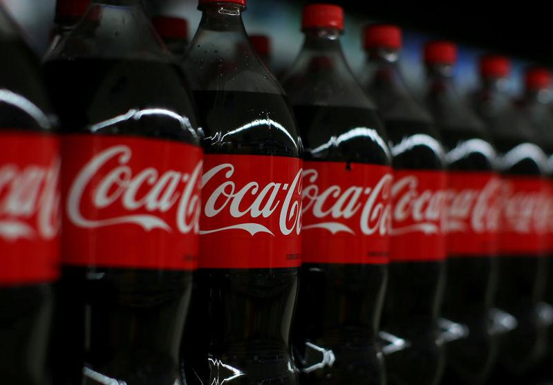 FILE PHOTO: Coca-cola soda is shown on display during a preview of a new Walmart Super Center prior to its opening in Compton, California,