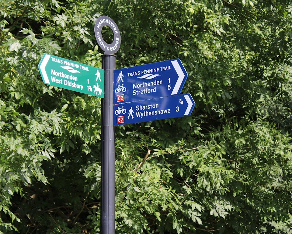 Manchester, England- August 24, 2016: A sign post for the Trans Pennine Trail, a 215 miles long route for walkers and cyclists linking the North and Irish seas, through the Pennines in northern England