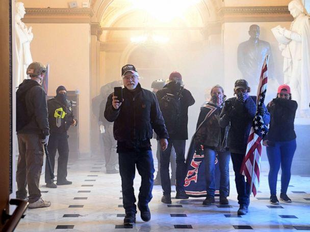 PHOTO: Supporters of President Donald Trump enter the U.S. Capitol as tear gas fills the corridor, Jan. 6, 2021, in Washington, D.C. (Saul Loeb/AFP via Getty Images)