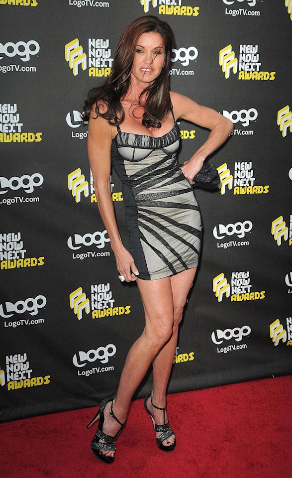 """The one and only Janice Dickinson strutted her stuff in an itty-bitty, spaghetti-strap dress and T-strap heels adorned with bling, as she prepared to pass out the prize for """"Best New Indulgence."""" Jordan Strauss/<a href=""""http://www.wireimage.com"""" target=""""new"""">WireImage.com</a> - June 8, 2010"""