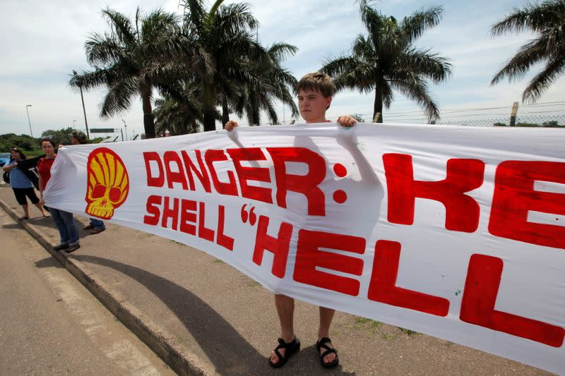 FILE PHOTO: Members of the Indigenous Environmental Network demonstrate against the Shell oil company outside the South African Petroleum Refinery (SAPREF) in Durban