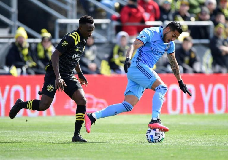 Ghanaian defender Harrison Afful (L) playing for Columbus Crew in an American Major League Soccer match this year.