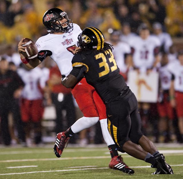 Missouri's Markus Golden, right, hits Arkansas State quarterback Adam Kennedy as he throws in the final seconds of the first half of an NCAA college football game Saturday, Sept. 28, 2013, in Columbia, Mo. (AP Photo/L.G. Patterson)