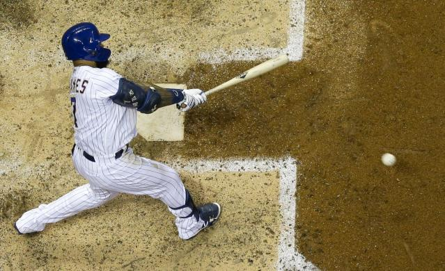 Milwaukee Brewers' Eric Thames hits an RBI single during the sixth inning of a baseball game against the San Francisco Giants Friday, July 12, 2019, in Milwaukee. (AP Photo/Morry Gash)