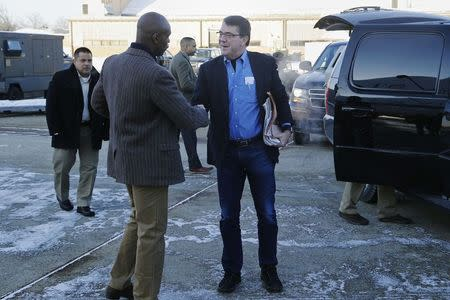 U.S. Secretary of Defense Ash Carter (C) is greeted by Senior Military Assistant U.S. Army Major General Ron Lewis (L) as they arrive to travel to Afghanistan from Joint Base Andrews, Maryland February 20, 2015. REUTERS/Jonathan Ernst