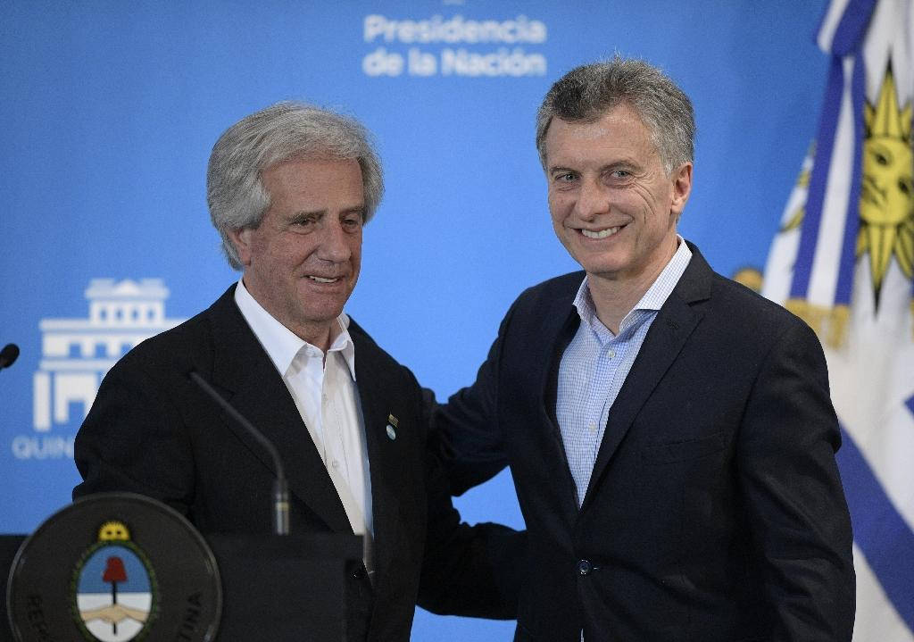 Uruguay and Argentina will officially launch their joint bid for the 2030 football World Cup next week at a ceremony involving the countries' two leaders, Uruguay's President Tabare Vazquez (L) and Argentina's counterpart Mauricio Macri (AFP Photo/Juan MABROMATA)