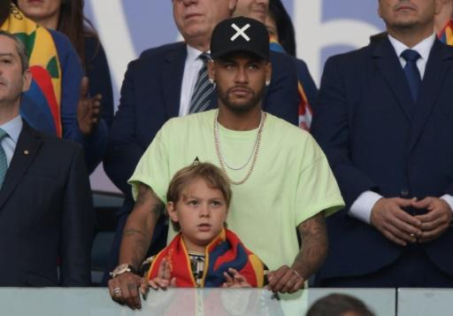 Injured Neymar and his son Davi Lucca watch Sunday's Copa America final at Rio de Janeiro's Maracana stadium from the stands