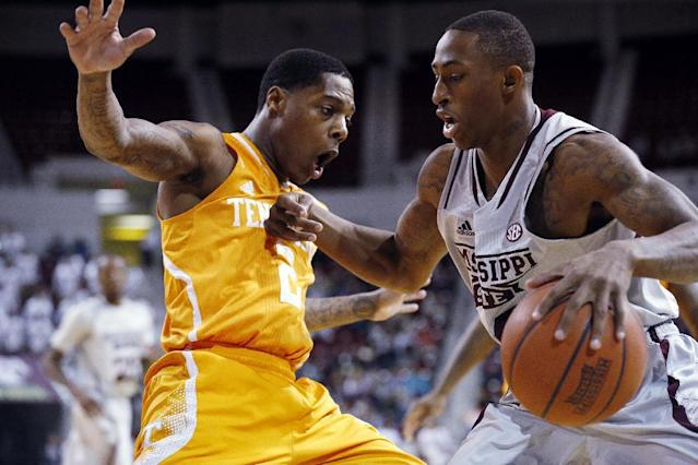 Mississippi State guard Craig Sword, right, dribbles past Tennessee guard Antonio Barton (2) in the first half of an NCAA college basketball game in Starkville, Miss., Wednesday, Feb. 26, 2014. (AP Photo/Rogelio V. Solis)
