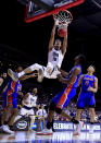 <p>Trey Porter #15 of the Nevada Wolf Pack dunks the ball against the Florida Gators in the first half during the first round of the 2019 NCAA Men's Basketball Tournament at Wells Fargo Arena on March 21, 2019 in Des Moines, Iowa. </p>