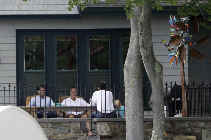 Republican presidential candidate Mitt Romney is seated with his sons Craig, left, and Tagg, right, at his vacation home on Lake Winnipesaukee in Wolfeboro, N.H., Sunday, July 1, 2012. (AP Photo/Charles Dharapak)
