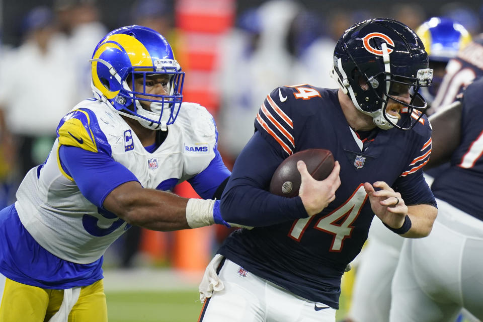Chicago Bears quarterback Andy Dalton, right, is hauled down by Los Angeles Rams defensive end Aaron Donald during the second half of an NFL football game Sunday, Sept. 12, 2021, in Inglewood, Calif. (AP Photo/Jae C. Hong)