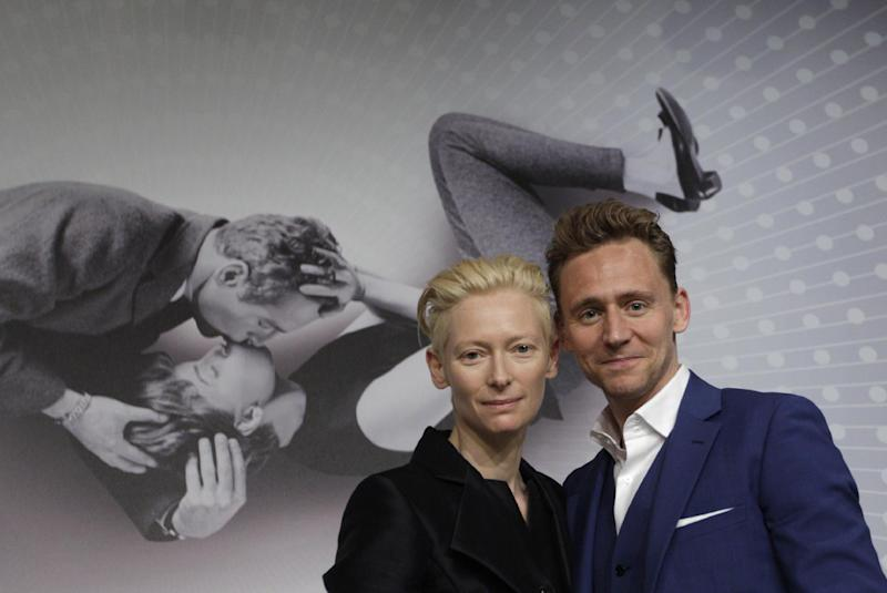 Actress Tilda Swinton, left, poses with actor Tim Hiddleston after a press conference for the film Only Lovers Left Alive at the 66th international film festival, in Cannes, southern France, Saturday, May 25, 2013. (AP Photo/Virginia Mayo)