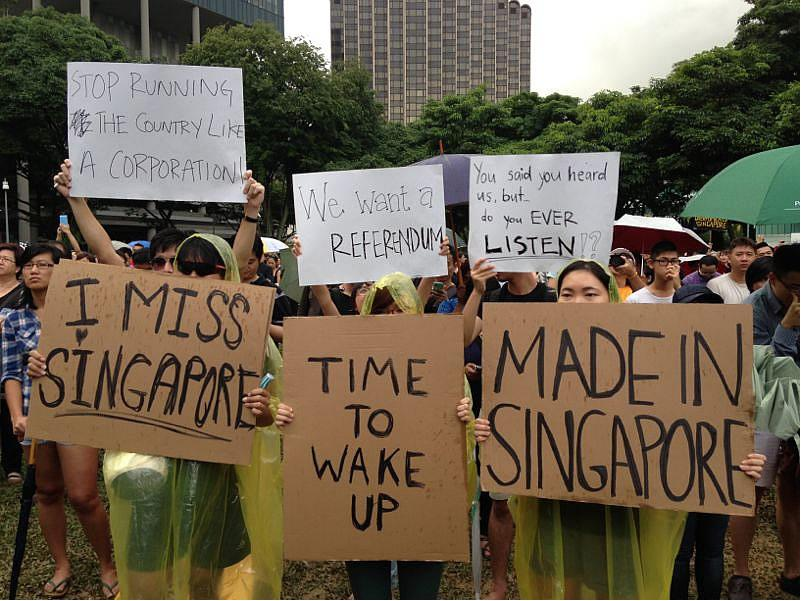 <p>Many in the crowd came armed with self-designed posters.</p>